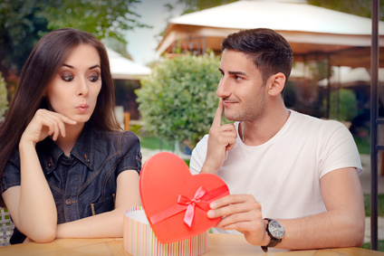 Surprised Girl Receiving Heart Shaped Gift from her Boyfriend