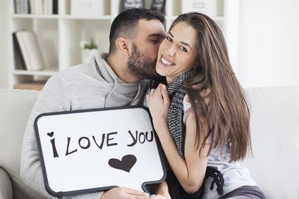 Young couple showing love message written on white board. I love you message. Valentines couple,shallow depth of filed