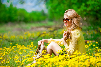 Attractive woman in yellow flowers