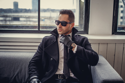 A man in sunglasses and black gloves.