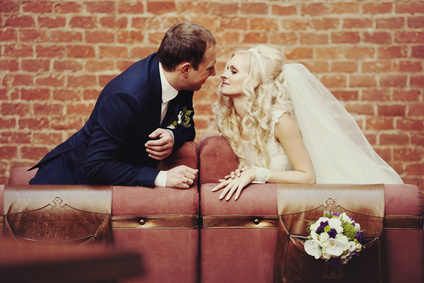 elegant stylish groom with his happy gorgeous blonde bride in th