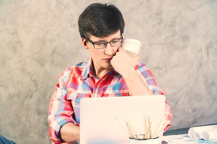 Worried man looking at screen