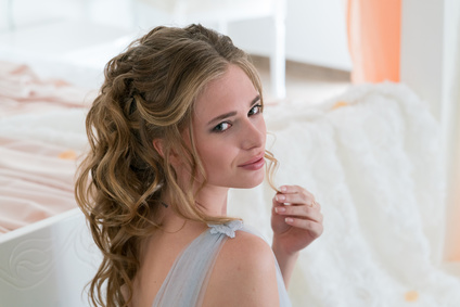beautiful young bride in a bedroom