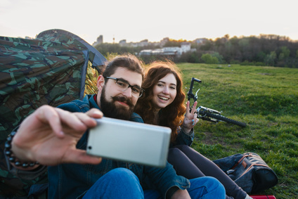 couple on vacation makes selfie. photographed themselves. campaign.